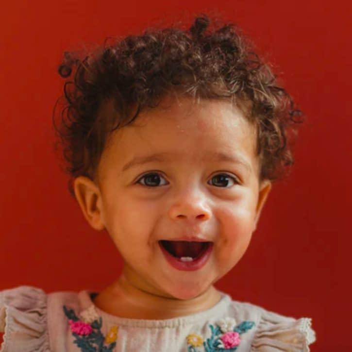 Humphrey Muleba, baby girl wearing grey dress